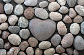 Pebbles with a heart-shaped pebble in the middle
