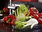 Fennel, tomatoes, peppers on worktop in kitchen