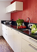 Kitchen with basil, peppers and fennel on worktop