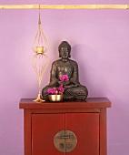 Buddha figure on cupboard
