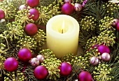 A burning candle in a wreath