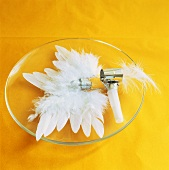 Plate decoration of white feathers and blowout