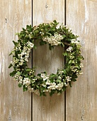 Hawthorn wreath hanging on a wooden wall