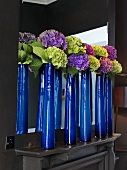 Hydrangeas in blue vases on mantel in Launceston Place (London restaurant)