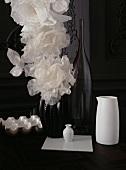 White tulle flowers in black vase