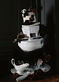 Stacked white bowls with white top hat and fabric flowers