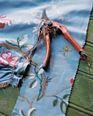 Blue fabric with floral pattern and secateurs