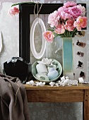 Peonies, white bowl and curls of torn wallpaper