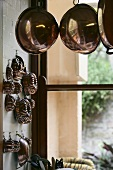 Copper bowls and cake tins in a kitchen