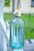 A blue soda bottle
