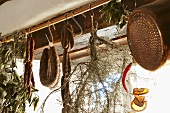 Dried herbs and hard sausages hanging from the ceiling