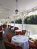 A pavillon restaurant by a lake (Hotel Pavillon Bleu)