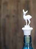 Bottle with a deer-shaped stopper