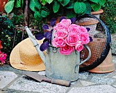 Bouquet of roses in a watering can