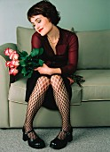 Woman with roses on couch