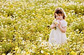 Girl in wildflower meadow