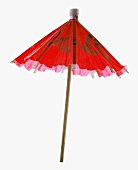 Partially Opened Red Cocktail Umbrella on White Background