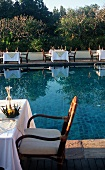 Tables Set Up Poolside at Four Seasons Hotel in Chiang Mia Thailand
