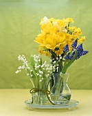 Three Glass Vases with Assorted Flowers, Daffodils and Grape Hyacinth