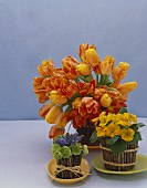Three Flower Arrangements in Stick Baskets on a Blue Background