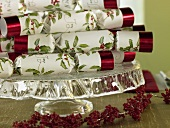 Christmas crackers on a cake stand with berry garland