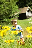 Young Boy in a Field of Wildflowers