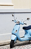 Blue Scooter Parked on Street in France