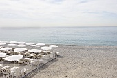 Chairs and Umbrellas Set Up on Beach; Nice, France