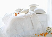 White Bed with Oranges