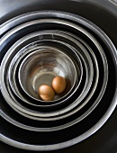 Two Brown Eggs in Stainless Steel Nesting Bowls