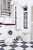 An old fashioned utility room with a black and white tiled floor