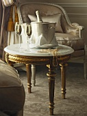 A festively decorated occasional table with glasses of champagne in an elegant setting