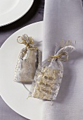 Christmas gift bags on a white place setting
