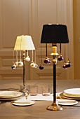 Table lamps decorated with Christmas baubles in an elegant atmosphere