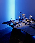 An atmospherically arranged meal with blue light