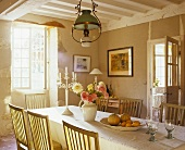 A long table in a dining room of a country house