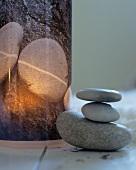 Pebbles illuminated by candlelight