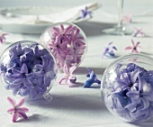 Decorative baubles with flowers inside