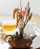 A spring flower arrangement in a ceramic pot