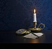 A candle, a fountain pen and caviar