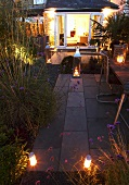 A garden lit with lanterns
