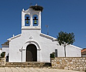 Church with a stork nest in the village of Los Marines (Andalusia, Spain)