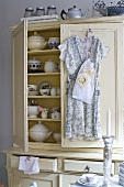 Country style crockery cupboard with the doors ajar