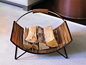 Wooden basket with a metal frame and firewood