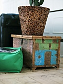 Plant pot with a circular pattern on a rustic wooden chest