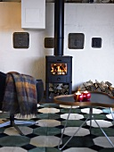Wood burning stove with a fire in a living room