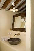 Rustic ensuite with washbasin, brass spigot and mirror
