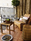 Cozy balcony corner with a wooden side table and basket chair on a wooden floor