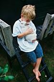 A boy with a white rabbit