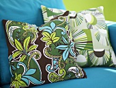 Patterned cushions on a blue armchair